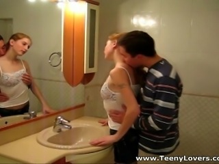 At somebody's birthday party these two horny teen lovers sneak away from the crowd to have some fun in a bathroom. No time for bed and long prelude no time to even fully undress when the lust takes over making them fuck in front of a large mirror and right in a bathtub. A tight fresh pussy and a firm young cock what else do you need for a powerful double orgasm?