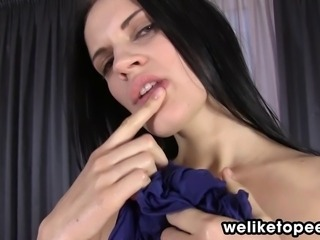 Sexy European Mia teases her piss soaked pussy lips and pees on the floor