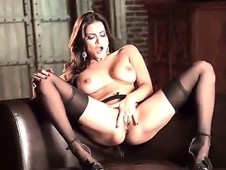 Dark haired babe Sunny Leone with big juicy boobs and stunning beautiful face in stockings and high heels spreads legs and fingers wet honey pot to warm orgasmic feeling.