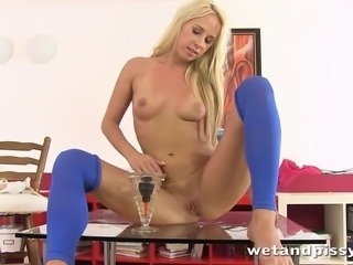 Carla Cox looks sexy in pantyhose and dips her feet in a big pissy mess