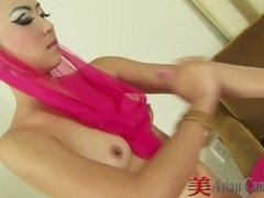 Thai cutie Ice dressing up in a sexy oriental outfit and rubbing lotion over...