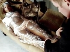 Black queen wrapped in plastic banged