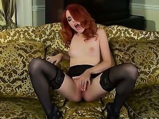 Young cute redhead Amarna Miller with natural perky boobies and sweet firm ass in arousing black lingerie and high heels teases and enjoys stretching wet pink pussy in living room.