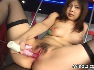 Bombastic looking Asian stripper with huge boobs sits down and starts masturbating like a real slut on stage.