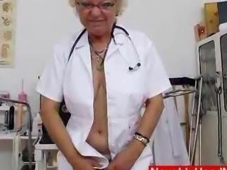 Woolly nurse grannie dildoes her twat