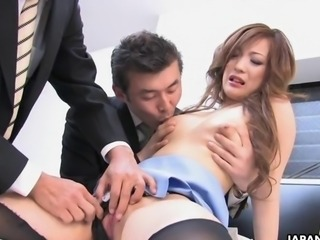 Enticing Japanese cutie suckles two wieners
