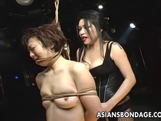 Luscious Asian slave slut moans while her mistress is tying her up. She gets down on all four while her mistress whips her hard.