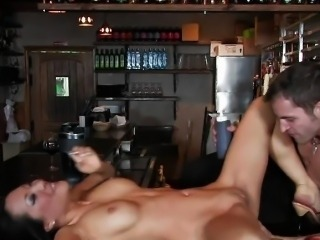 Business woman strips for bartender on the bar