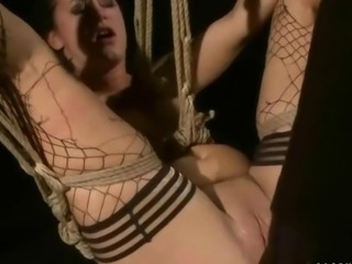 Brunette gets tied up and fucked hard in a bdsm scene
