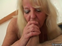 Blonde granny pleases a stranger