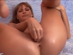 The camera explores Paula s wet pussy for a minute  With her legs spread wide...