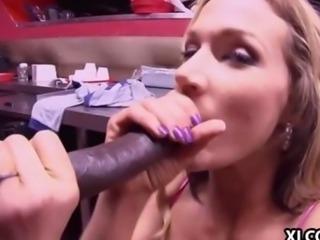 Busty MILF Nikki Sexx sucking on a cock