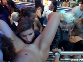 Sexy lesbian club babes lick and finger twats in public