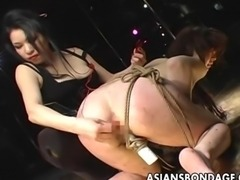 Captivating Asian mistress whips a tied up slut