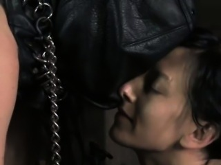 Bondage hooded sub in puppy play trainment