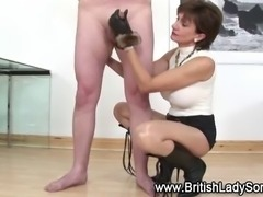 Pantyhose clad Lady Sonia gives fetish gloved handjob