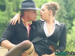 Glamorous clothed babe takes cumshot after fucking outdoors