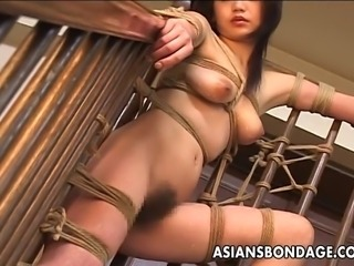 Craving Japanese cutie groans while her randy master is playing with her pussy. He ties her up and covers her smooth body in candle wax.