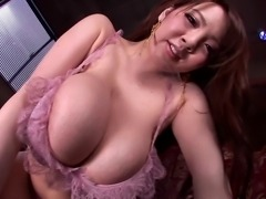 Incredible asian with monster tits posing in lingerie and pressing her giant...