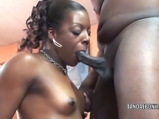 Ebony slut Anastasia in a sexy bikini and on her knees to swallow a stiff black cock