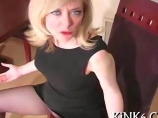 Nina Hartley poses in see through pantyhose