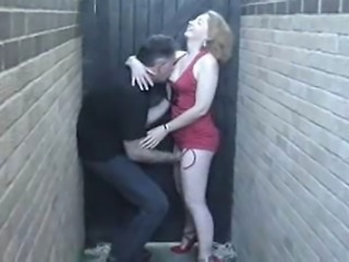 sexy redhead has fun at the side of her house with a stranger