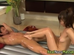 Petite asian masseuse gives footjob to client in hi def