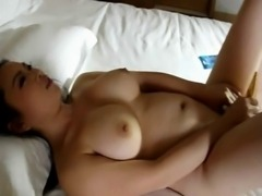Busty Asian girl masturbates