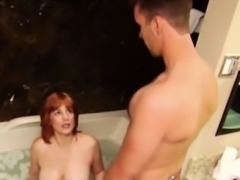 Perv surprises a gorgeous redhead taking a bath in his house