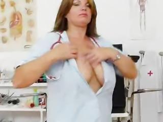 Madame brunette masterbates in medic uniforms