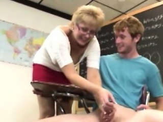 Spex mature teacher pulling his cock