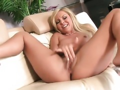 Aaliyah Love strips naked to give a close-up view of her pussy in solo scene