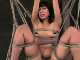 Suspended frogtie bondage for skanky submissive whore