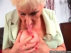 Grandma in stockings massages her big tits and old pussy free