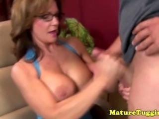 Mature handjob lover spoiling guys dick with tug job