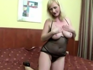 busty mature mom and her big black dildo
