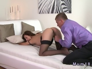 Sexy brunette mature lady in lingerie gets her pussy and asshole licked from...