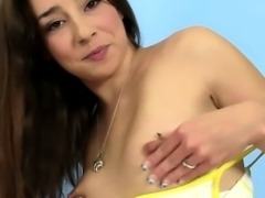 Solo pee fetish brunette toying her pussy