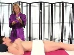 Masseuse tentatively rubs pussy