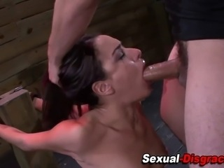 Restrained sub gets throated and gags on masters cock