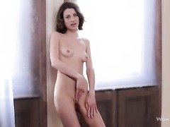 Virginie with bald beaver has fire in her eyes as she fucks herself with dildo