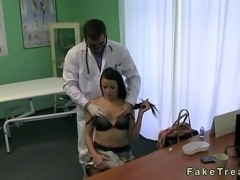 Doctor in his uniform massages stiff neck of hot brunette patient and soon he...