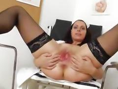 Speculum in a tight madam medic pussy