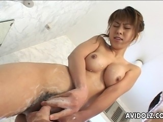 Dreamy Japanese slut with big natural hooters slurps her lover's hard dick. She slides her wet pussy down his throbbing rod and rides on it wildly.