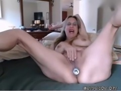 hot mature granny with big tits inserts anal plug and rubs her pussy