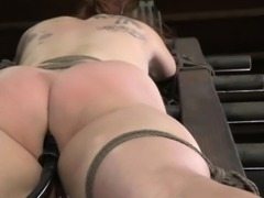 BDSM sub Bella Rossi with nipple and clit clamps flogged