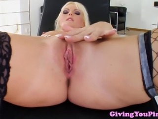Solo blonde masturbating her vulva with her dildo