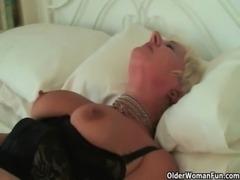 Highly sexed grandma Sandie rubs her pierced clit free