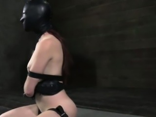 Master makes submissive beauty wear a latex mask