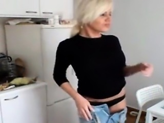 Super sexy blonde milf strips in her kitchen on cam